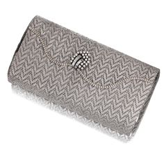 Gold and diamond evening bag - Of rectangular form and chevron design, the scalloped hinged cover applied with a line of single-cut diamonds, opening to reveal a mirror, to the brilliant-cut and baguette stone thumbpiece, mounted in white and yellow gold,