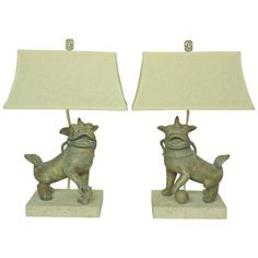 Pair of Ceramic Foo Dogs Lamps Fossil Stone Bases Style of Michael Taylor | From a unique collection of antique and modern table lamps at https://www.1stdibs.com/furniture/lighting/table-lamps/