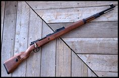 The Karabiner 98 Kurz (often abbreviated Kar98k, K98, or K98k) was a bolt action rifle chambered for the 7.92×57mm Mauser cartridge that was adopted as the standard service rifle in 1935 by the German Wehrmacht.