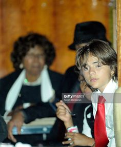 Prince Michael Jackson (age 12) at his father Michael Jackson's funeral on September 3rd 2009 with his cousin Jermajesty (age 8) and their Grandparents Joseph and Katherine.