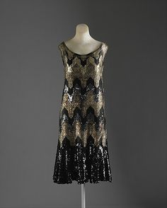 """Evening Dress Attributed to House of Chanel (French, founded Designer: Attributed to Gabrielle """"Coco"""" Chanel (French, Saumur Paris) Date: Culture: French Medium: silk, metallic thread, sequins Dimensions: Length (a): 42 in. cm) Length (b): 38 in. 20s Fashion, Fashion History, Art Deco Fashion, Vintage Fashion, Couture Vintage, Vintage Chanel, Coco Chanel Historia, Vestido Art Deco, Style Année 20"""