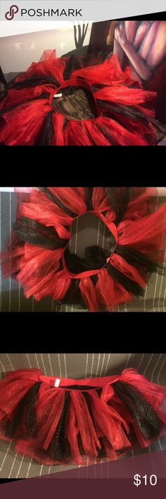 Sexy Adult Tutu Black & Red ~like new~ Halloween This tutu has multiple layers of black and red. Halloween costume ideas - funky black swan, jazzy ballerina, cosplay, french maid, circus carnie, gothic, steam punk, goth princess, sexy vampire, Victorian temptress, lady devil, dance wear, tutu parties at music festivals, raves, and concerts, medieval renaissance fair wench. Excellent like new condition. Small but stretchy(I'm size 5 wearing it in last pic). Wear under skirt or dress like…