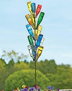 Placing empty glass bottles in the garden began as a way to capture evil spirits. These days, a bottle tree is an easy way to create one-of-a-kind garden art. Set includes steel tree tall) and 18 colorful bottles to arrange and rearrange! Wine Bottle Trees, Wine Bottle Art, Wine Bottle Crafts, Wine Tree, Diy Wine Bottle Bird Feeder, Wine Bottle Planter, Blue Bottle, Bottle Lights, Empty Glass Bottles