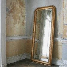 A mirror that leans against the wall...a sweet touch to a romantic home.