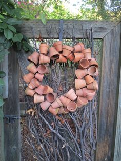 I love this Garden Gate and the Clay pot wreath on branches! ...hopefully I can make this!