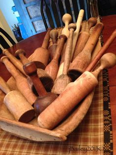 A nice display of wooden mashers in a wooden dough bowl?