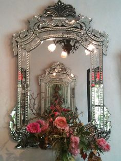 gorgeous venetian mirror and pretty flowers!
