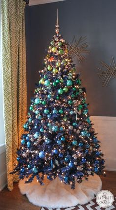 Navy Blue Christmas Tree decorated with greens, blues, and copper inspiredbycharm.com