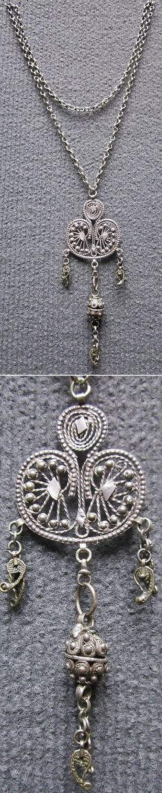 Silver necklace with filigree pendant.  Probably from southeastern Anatolia, late-Ottoman, ca. 1900.  The chain is 58 cm long.  Size of the pendant: 11 cm (including the dangles).  (Inv.n° müç076 - Kavak Costume Collection, Antwerpen/Belgium).