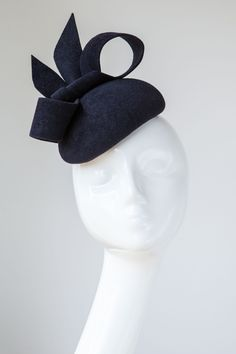 Handmade in our London studio.Peachbloom felt cocktail hat with bow detail. Colour: Black.Please enquire if you would like this in an alternative colour.Secured with a comb and elastic.1 in stock. UK delivery 3-5 working days.Sent free within the UK. Includes a Black