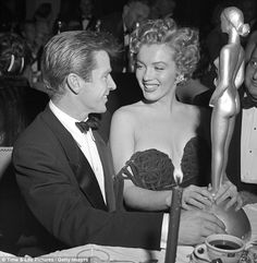 Marilyn Monroe appears to be more friendly with her neighbor, American actor Richard Basehart, as sh...