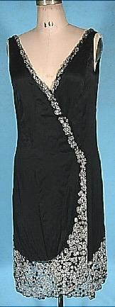 c. 1926 Black Silk Charmeuse Wrap Flapper Dress with Bead Trim! This dress stumps me a bit...the bead trim is unquestionably vintage 1920's.. but I wonder if the silk charmeuse is old fabric re-designed into a new dress. There is nothing but a hint that it isn't all original. And certainly it's the beading that is so special... not to mention how SEXY this dress is on! The silk drapes beautifully on the body! And you can size a bit to fit by just changing the snap closure at waist. Get the…