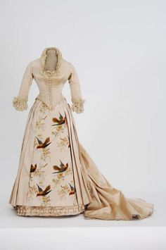 Ivory satin bustle dress with a front panel of woven velvet flowers and birds. Worn by Mary Lanpher