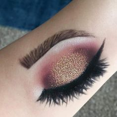 Realistic makeup on the arm, eyeshadow shading with eyeliner and detailed eyebrows