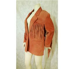 Springwest Fringed Suede Vintage Jacket/Blazer Springwest Suede Jacket is 100% leather and has long fringes on the arms, across the back and along the front. The color of the jacket is like a nice burnt orange color. One button closure. Inside pocket. Falls below the hips. Size S/M Vintage Era 80's -90's Great Condition. Springwest Jackets & Coats