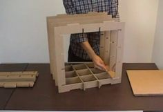 stri-cube by dany gilles. cardboard modular bookcase