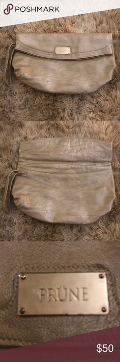 PRÜNE made in Argentina clutch Metallic taupe leather Prüne clutch with wrist strap.  Fold over and magnetic snap closure.  Excellent condition. Made in Argentina, Prüne is known for their great quality bags and classic styles. Prune Bags Clutches & Wristlets