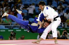 Spain's Francisco Garrigos (white) competes with Germany's Tobias Englmaier during their men's -60kg judo contest match of the Rio 2016 Olympic Games in Rio (1200×800)