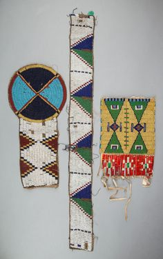 THREE SIOUX BEADED HIDE FRAGMENTS.