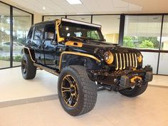 Black and gold 2014 Jeep Wrangler Unlimited Sport $49,997