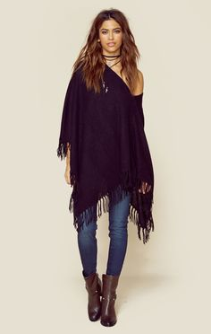 """If you want to stay super cozy and look your best, this fringe poncho by Minnie Rose is the perfect piece for you. Featuring a cashmere fabrication, fringe detailing, and relaxed body. Can be worn off the shoulder or as a cowl neck!ImportedDry Clean Only100% CashmereFit Guide:Model is 5ft 7 inches; Bust: 33"""", Waist: 23"""", Hips: 33""""Model is wearing a size 0/sShoes Featured Not Available For Purchase"""