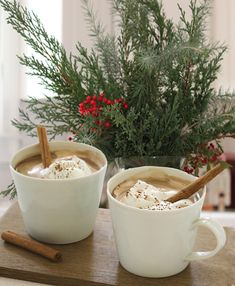 Cocoa with whipped cream and cinnamon sticks