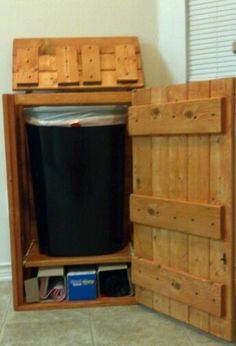 my husband built this garbage can storage cabinet the drawer pulls out too hidden