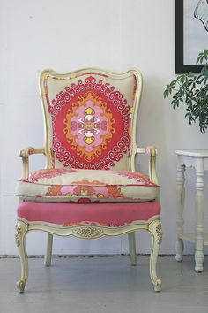 Wonderful use of patterned fabric and color on this chair! Notice the placement of the motif ... centered on the back and off-centered on the seat cushion.  Adds more interest.