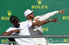 Race winner Lewis Hamilton, Mercedes AMG F1 celebrates on the podium with Usain Bolt