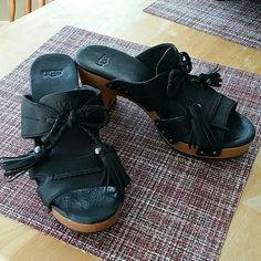 Super comfy ugg slip on sandals In excellent condition.  Size 5 but I think it'll work for our friends who are 5.2 and maybe 6 as well.  Black good quality genuine leather.  Cute!  Enjoy:) UGG Shoes Mules & Clogs