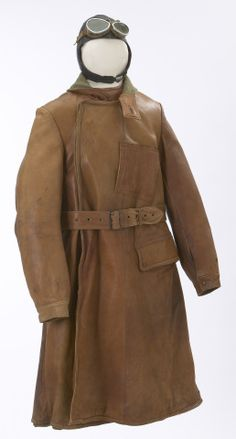 Circa 1917 Jacket, Helmet, and Goggles - worn in the airplane cockpit.