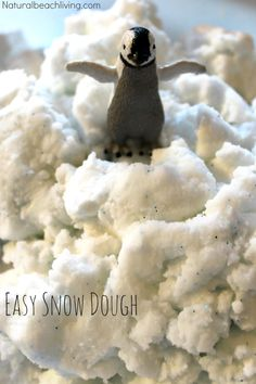 Easy to Make Homemade Snow Dough, ONLY 2 ingredients and it's just like real snow. DIY sensory play perfect for winter. Perfect for an Arctic Unit Study too