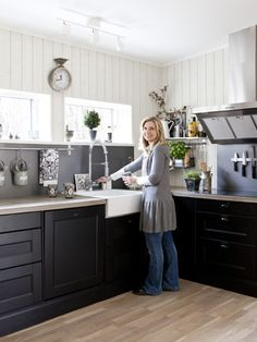 Swedish kitchen - this is it! Floor color, cabinet color, counter color. Still nice and bright.