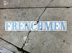 This is a street sign from an older part of New Orleans, when the signs were set right into the sidewalk at the street corner.