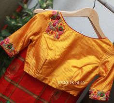 Beautiful yellow color designer blouse with floral design hand embroidery thread work on yoke.  25 October 2017