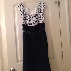 Dress Adorable black and white dress! Is dry clean only. New with tags. Never worn! Perfect for Spring or Summer! Would look great with heels or flats.The dress is lined and has a patent leather belt. London Times Woman Dresses Midi