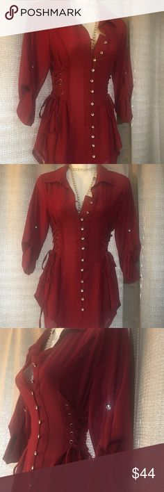 ⭐️Super fabulous button up top❤️ ⭐️NWT. never worn super fabulous dark red (almost maroonish) button up top.  Corset sides and beautiful clear stone buttons. This top is fitted and fabulous. You can dress this up or wear it casually, either way it's beautiful. Perfect for the holidays coming up! Extra button included(still attached to the tag thing)  this came from a fabulous boutique in Laguna beach California. Original price: $67.99 Tops Button Down Shirts