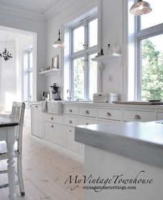 Love the floors, cabinets & countertop...