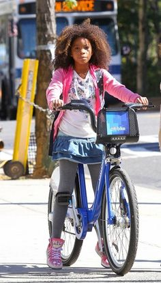 """Quvenzhane Wallis was spotted riding her bike on set while shooting the remake of """"Annie"""" on location in Harlem, New York."""