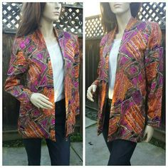 "Beautiful Geometric Jacket Gorgeous fuschia, cream, brown orange and black geometric material. Some areas are metallic while other areas aren't fully lined. No size or content tag. Measurements are: length 28"", shoulders 17"", arms 22"", chest 17"". I'd estimate it as a 4/6. Made in Manila kimi BF CREATION Jackets & Coats"