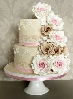 Vintage Bouquet..The Enchanting Cake Company  Perfect for a hint of retro flair, the Cocoa Rose Cascade cake from The Enchanting Cake Company mixes soft pinks and sepia tones for a lush romantic look that suits any vintage wedding. There are more than 10 delicious flavours to choose from for the tiers too.