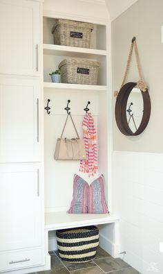small mud room storage school house coat hooks white shaker cabinets pet storage-1