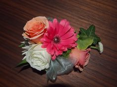 Custom prom corsage of mixed colors using sonya peach roses, white roses, pink gerber daisy, ivy and silver gray ribbon with matching boutonnière. www.urbanelements... Portland, OR
