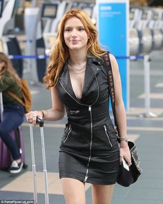Rockin red head: Thorne wore a tight-fitting black leather dress which showed off her legs...