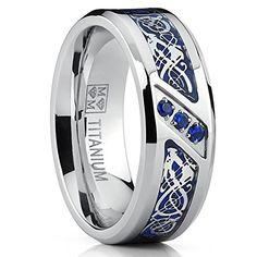 Titanium Wedding Ring Band with Dragon Design Over Blue Carbon Fiber Inlay and Blue Cubic Zirconia SZ 8 Metal Masters Co. http://www.amazon.com/dp/B016X3QE6Q/ref=cm_sw_r_pi_dp_QVDexb1WB49S9