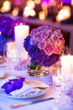 Photographer: One and Only Paris Photography; stunning purple wedding centerpiece