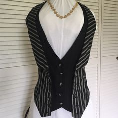 MAD MEN POWER VEST!  Adorable Love this double vested look with back flounce to add a feminine touch of interest.  Super cute seaming and details.  I promised myself I would introduce some great pieces during my POSH CO HOST.  I won't be sad if this doesn't sell. Double Zero Tops
