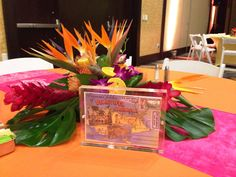 A taste of the Caribbean with bright linens and lively florals! www.konceptevents.com