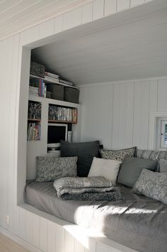 Daybed nook with mini bookshelf. What a great place to curl up on bad days.