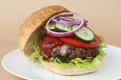 This home style hamburger tastes as good as it looks. By including the bacon short cuts in the patty mix, you get all the taste without the added fat. Yummy Food, Delicious Recipes, Healthy Choices, Hamburger, Bacon, Sandwiches, Beef, House Styles, Ethnic Recipes